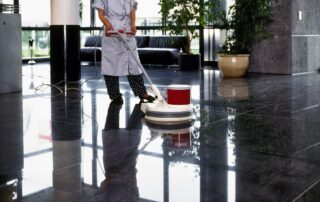 Adult cleaner maid woman with uniform cleaning corridor pass flo